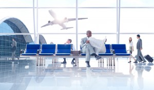 people at airport with plane in background iStock_000020206870_Small