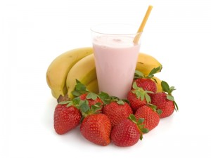 Smoothie made with strawberries and bananas isolated on white background
