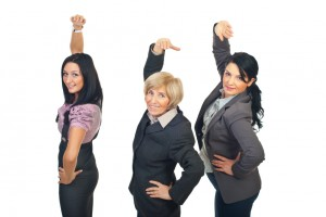 Team of businesswomen stretching hands