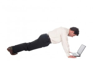 push ups over laptop iStock_000002544540Small