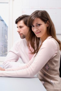 Businessman and woman in office