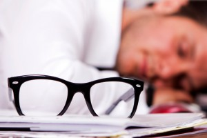 Man asleep at desk iStock_000021062971_Small