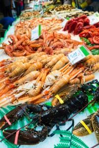 lobsters, shrimps and prawns for sale at La Boqueria market in Barcelona, Catalonia, Spain