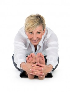 manager woman doing yoga at white background