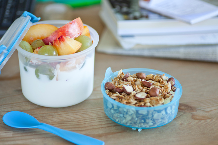 Granola with yoghurt and fruits to go.