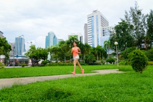 Fitness woman running at city park in Bangkok