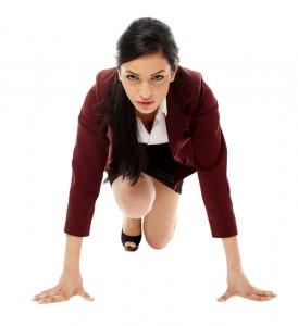 Hispanic businesswoman preparing for race