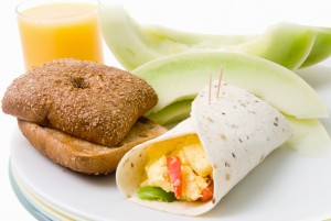 Breakfast Burrito Served with Honeydew Melon Toast and Orange J