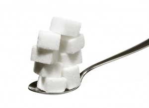 A spoonful of stacked sugar cubes