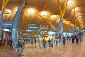 Passengers walk by at the new terminal at Barajas airport