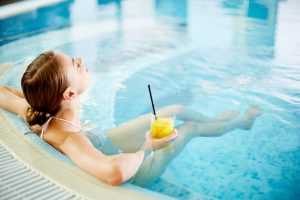 Airport hotel fitness facilities include Jacuzzi and pool.