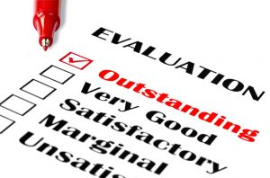 """Outstanding evaluation. Red pen on evaluation form, with """"outstanding"""" checked. http://robynm.smugmug.com/photos/175514497-L.jpg"""