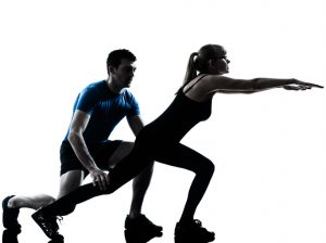 Personal trainer with mature woman exercising fitness workout